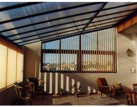 installateur-veranda-coulisant-store